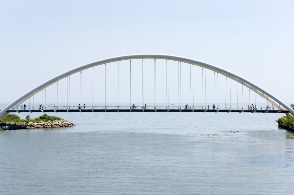 The Humber Bicycle and Pedestrian Bridge spanning over the mouth of the Humber River with Lake Ontario behind